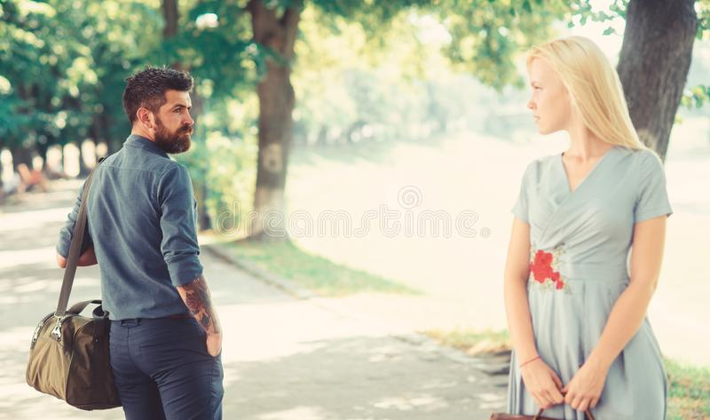 Love at first sight concept. Casual encounter, meet. On sunny summer day, nature background, defocused. Man with beard and blonde girl stopped to get acquainted stock photography
