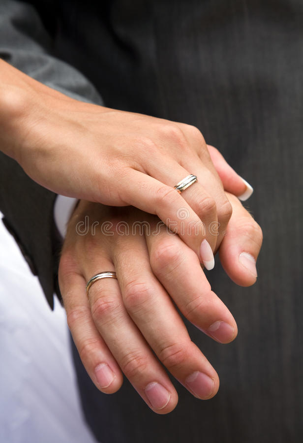 Love forever. Hand of the groom and the bride with wedding rings royalty free stock photography