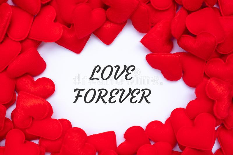 LOVE FOREVER word with red heart shape decoration background. Love, Wedding, Romantic and Happy Valentine' s day holiday. Concept royalty free stock photos