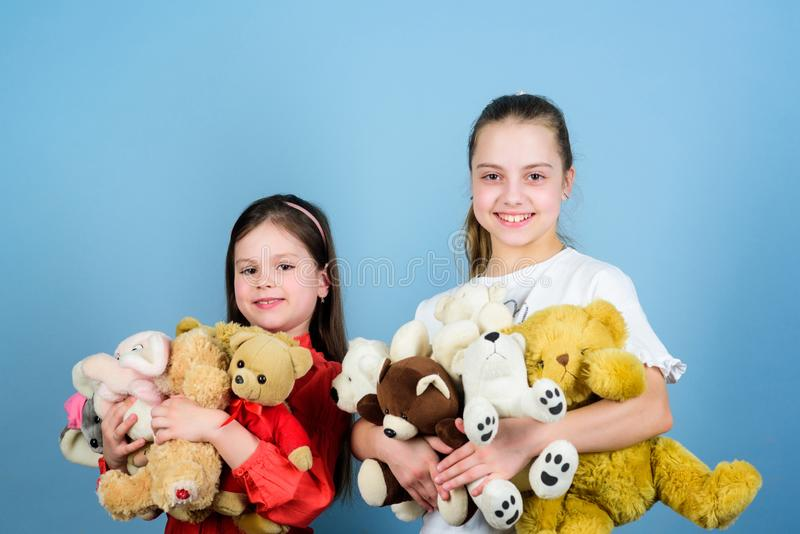 Love and friendship. Kids adorable cute girls play soft toys. Happy childhood. Child care. Sisters best friends play. Sweet childhood. Childhood concept royalty free stock photos
