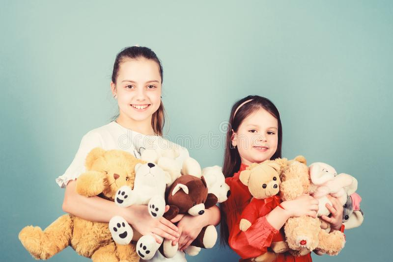 Love and friendship. Kids adorable cute girls play soft toys. Happy childhood. Child care. Sisters best friends play royalty free stock photography