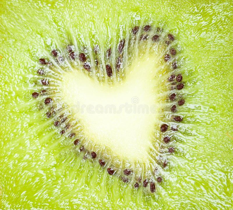 Love the fruits. Texture section kiwi fruit in shape of a heart - love for the fruits concept stock images
