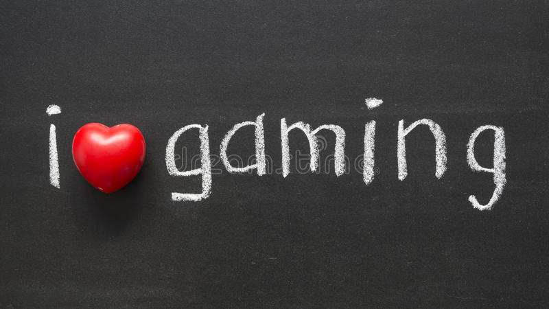 Love gaming. I love gaming handwritten on the school blackboard royalty free stock photography