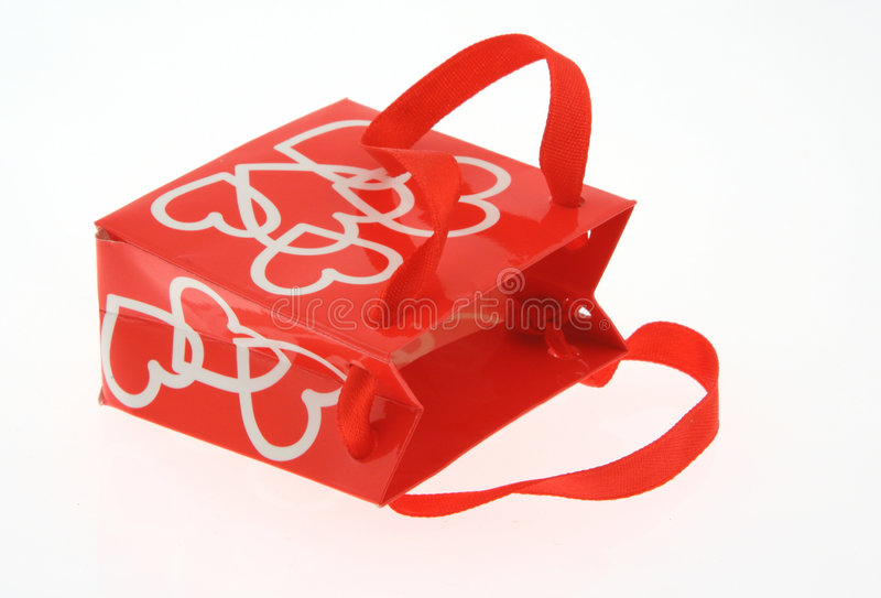 Love gift bag on white. Detail of toy love gift bag on white background royalty free stock photo
