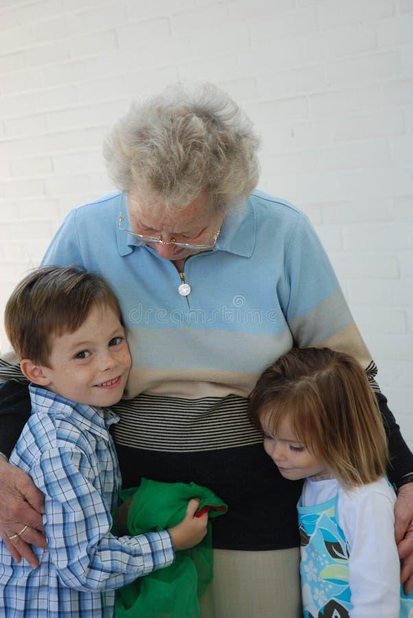 Grandma is the best. Grandchildren and her great grandma royalty free stock image