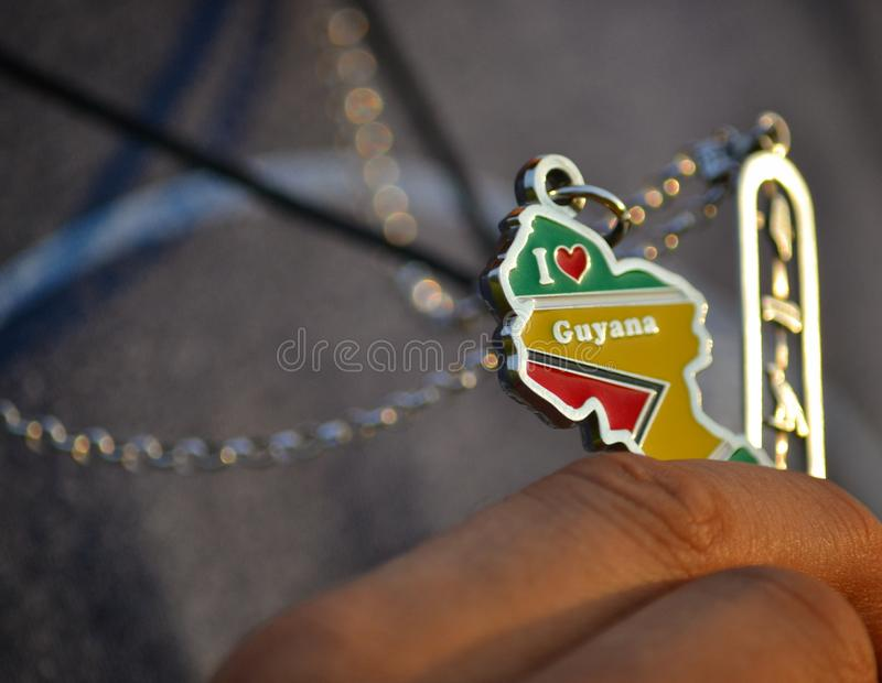 For the love of Guyana. I ❤ Guyana key chain in the light of golden hour royalty free stock photo