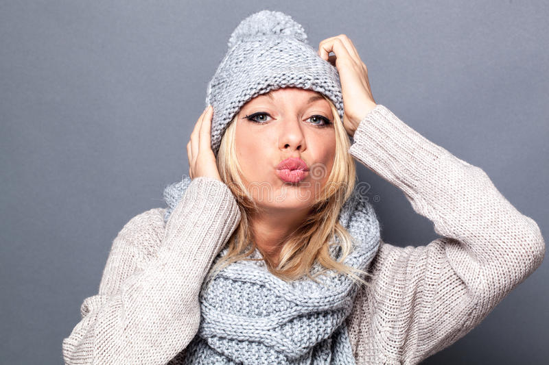 Love and happiness concept for pouting fashionable blond girl royalty free stock photo