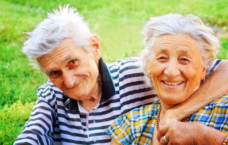 Love: happy joyful senior couple outdoor