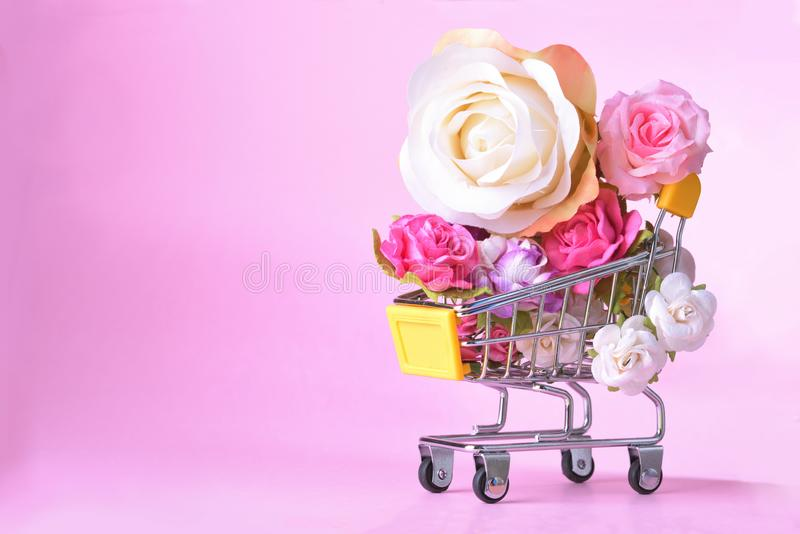 Love and happy Valentines day roses colorful in shopping cart stock photography