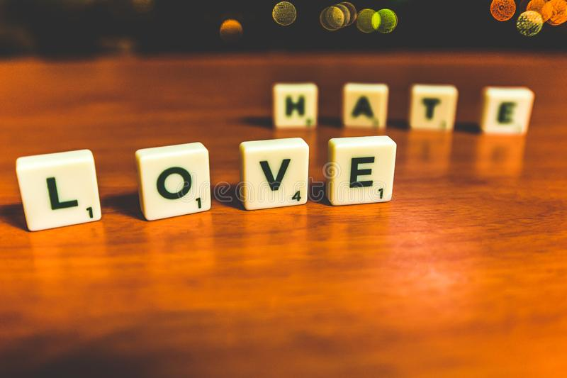 Love and hate - scrabble pieces royalty free stock image