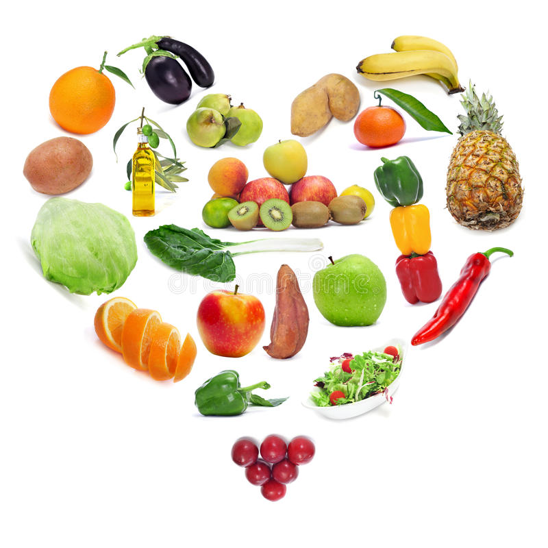 Love for the healthy food. Fruits and vegetables forming a heart royalty free stock photography