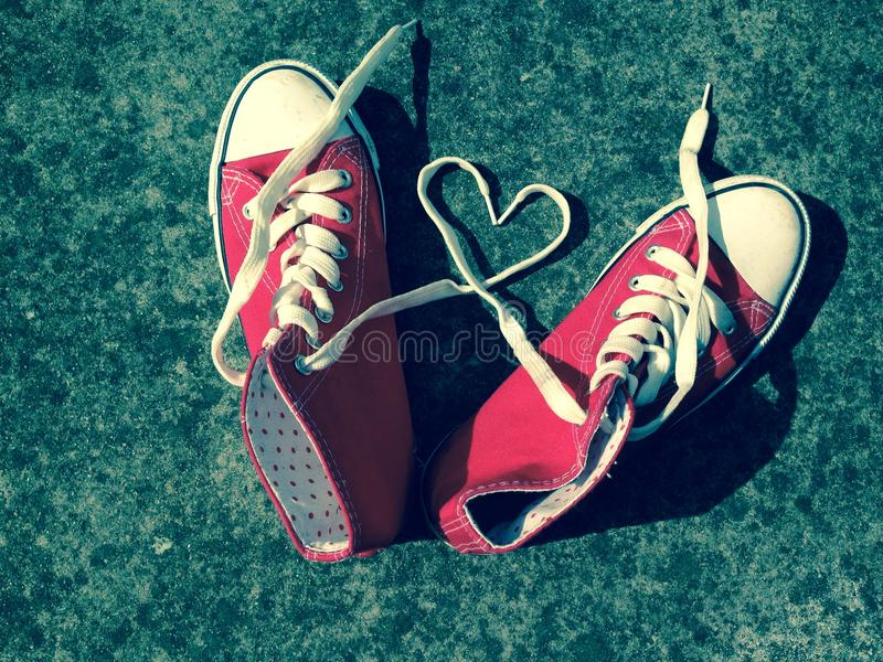 Love heart baseball boots sneakers laces copy space stock, photo, photograph, image, picture. Love heart baseball boots sneakers laces red with laces in heart stock photography