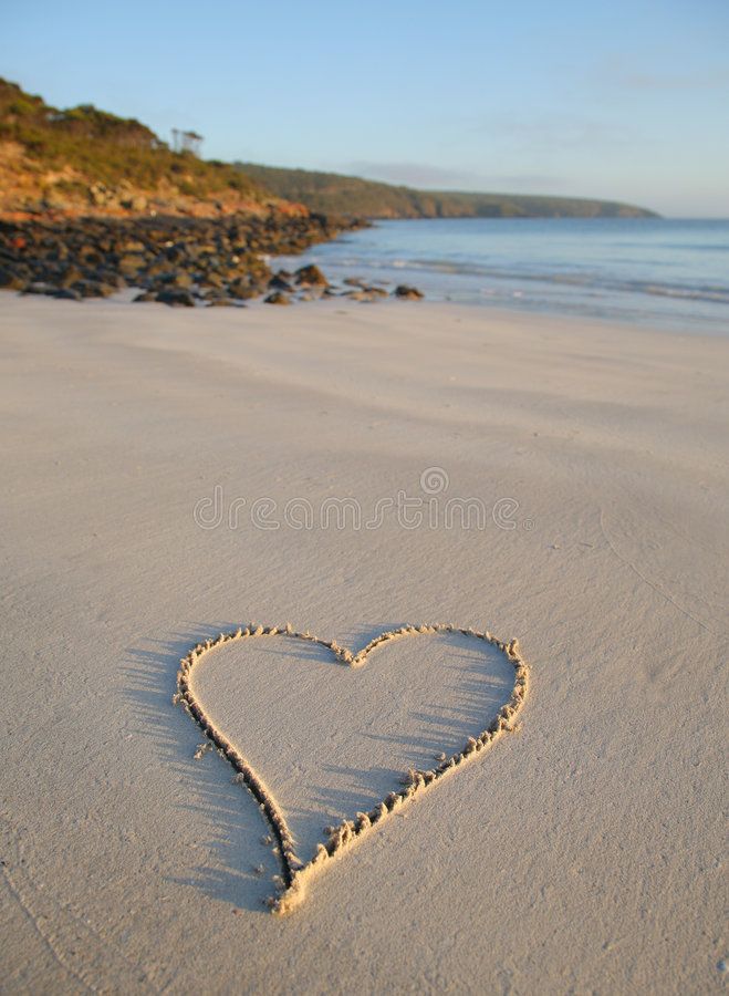 Love heart on beach royalty free stock photography