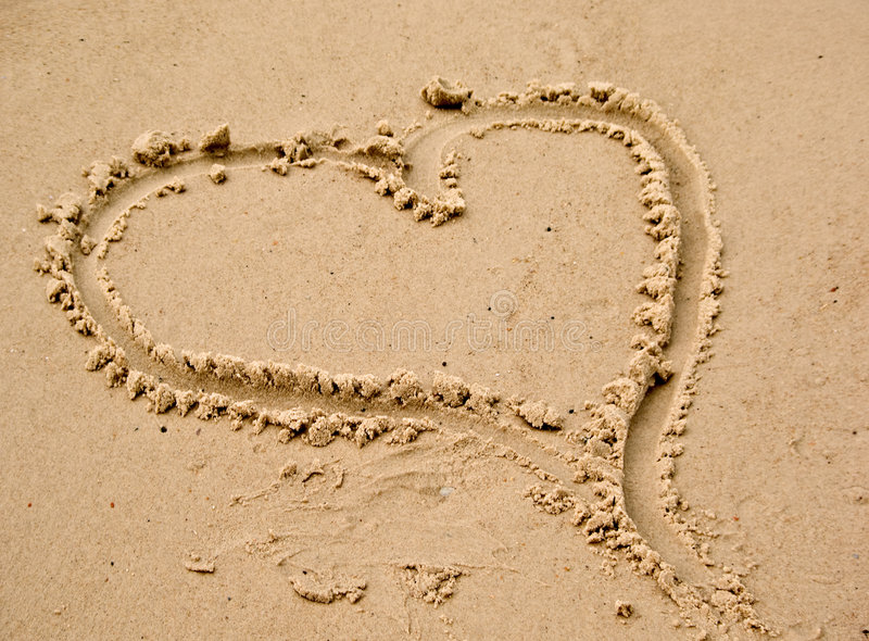 Love heart in the beach sand stock images