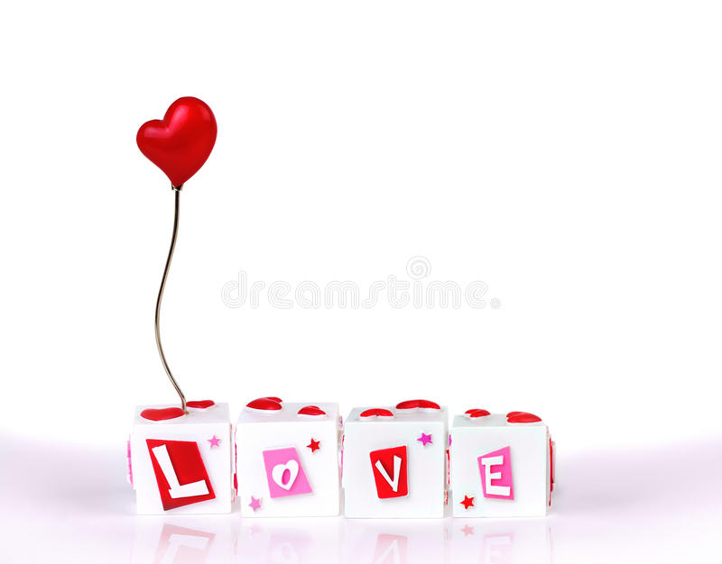 Love and heart from a cube puzzle. Isolated over white background stock photos