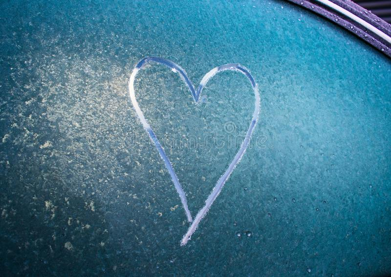 Love heart drawn on a frosty car windscreen stock photos
