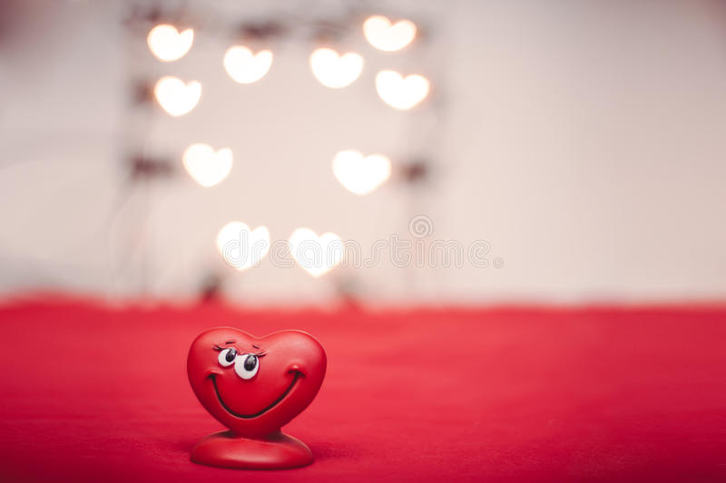 Love heart. Happy red love heart with heart bokeh Valentines Day background royalty free stock image