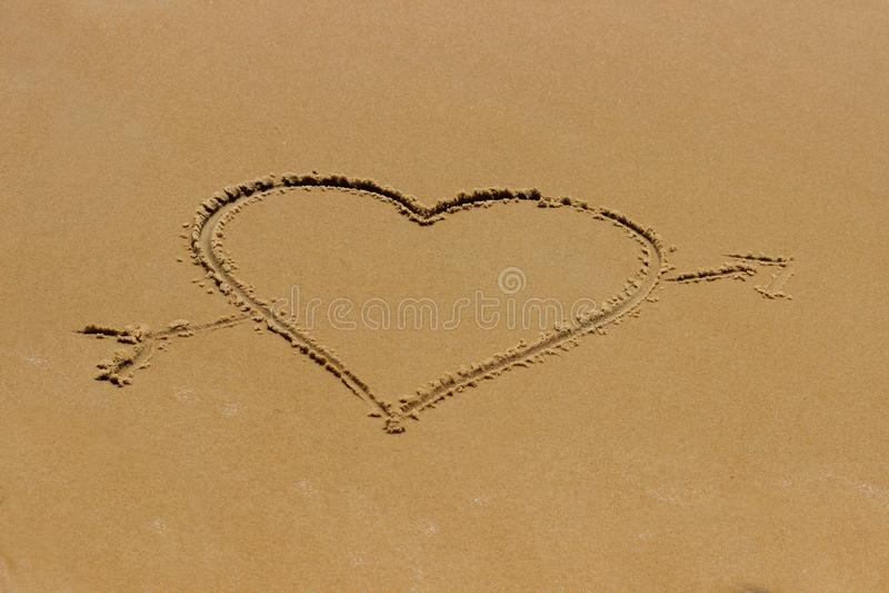 Love heart romantic beach. stock photos