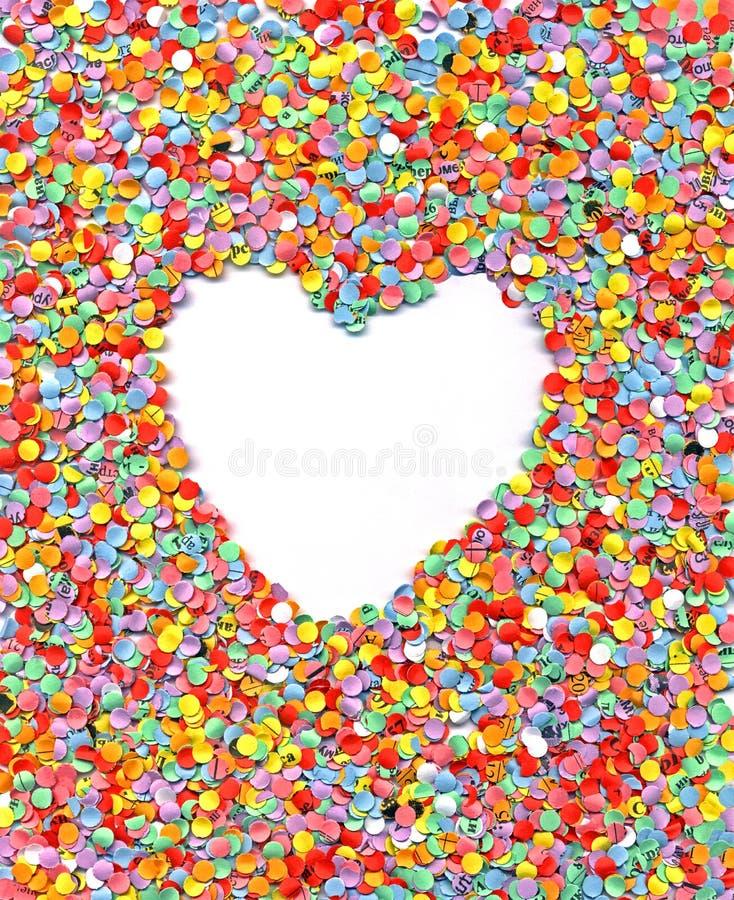 Love, heart, wedding, rainbow confetti background,. Abstract heart on rainbow confetti background, paper texture closeup royalty free stock photo