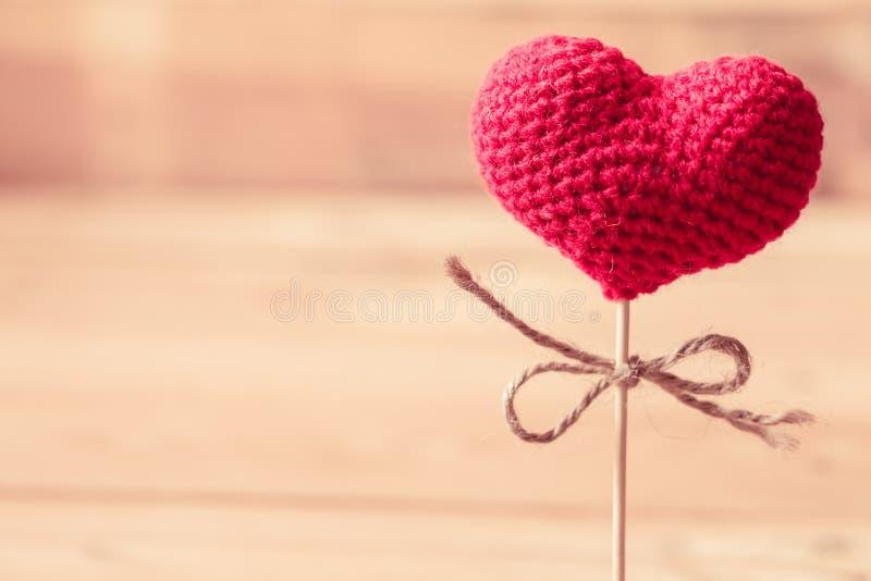 Love heart yarn on wood stick. royalty free stock photography