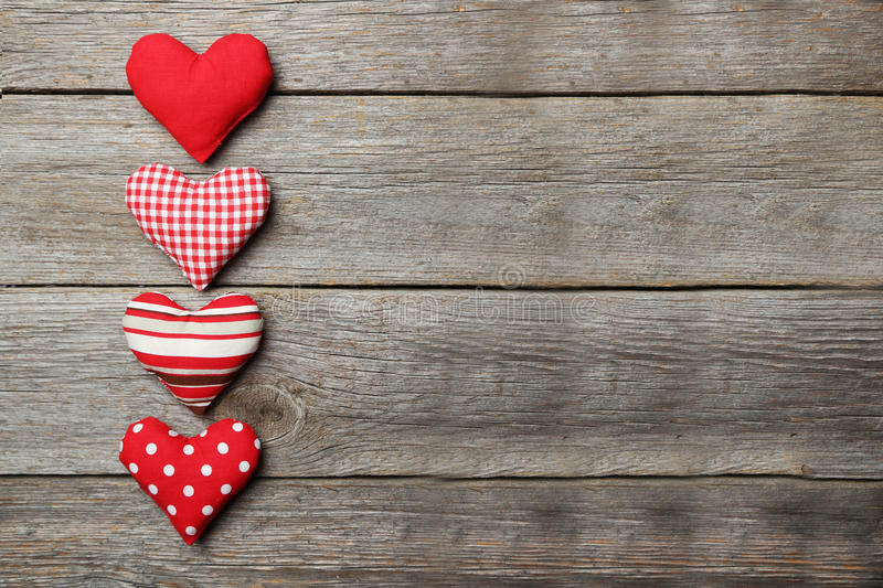 Love hearts on the grey wooden background stock image