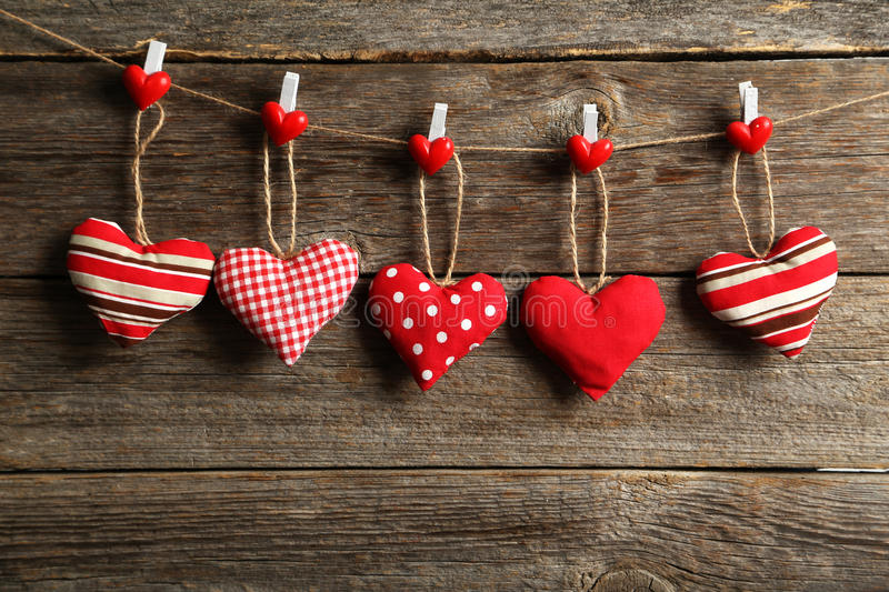 Love hearts. Hanging on rope on a grey wooden background stock photography