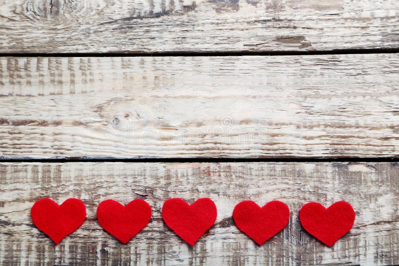 Love hearts. On a grey wooden table stock photo