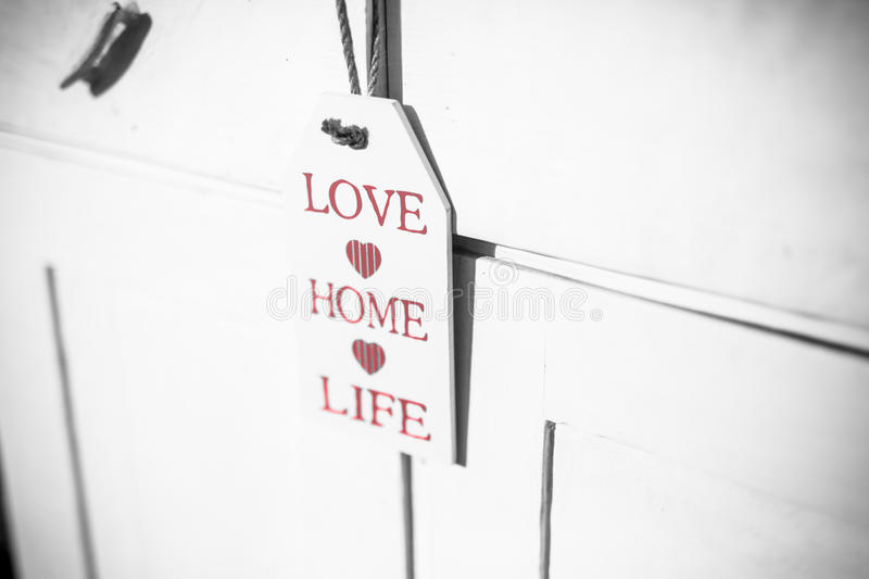 Love home life sign decoration. Christmas decoration and ornaments on rustic wooden background. Retro style dark colored picture with light effects. Shallow stock photo