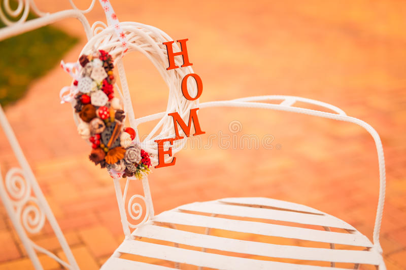 Love home life sign decoration. Christmas decoration and ornaments on rustic wooden background. Retro style dark colored picture with light effects. Shallow stock image