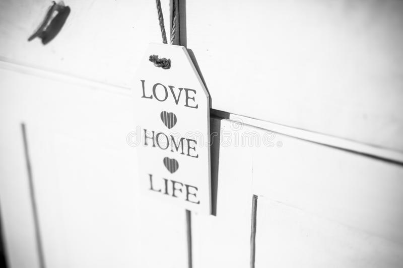 Love, home, life sign on wooden ornament and positive thinking wooden plaque stock image