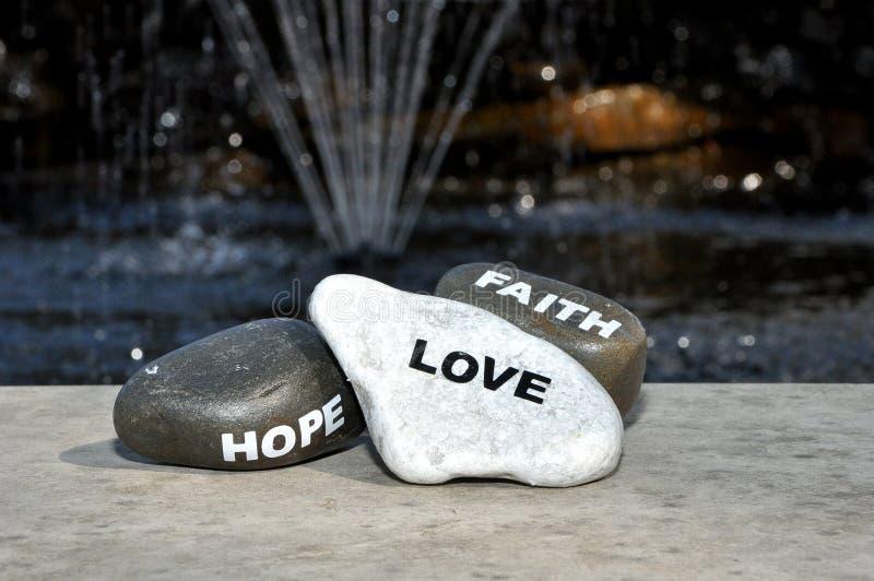 Love hope and faith stock photos