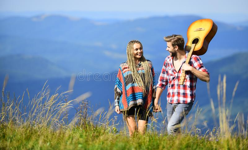 Love inspires them. Beautiful romantic couple happy smiling faces nature background. Boyfriend and girlfriend with stock images