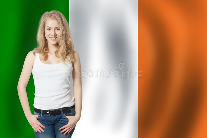 Love Irish concept. Happy cute woman with Irish flag.  royalty free stock images