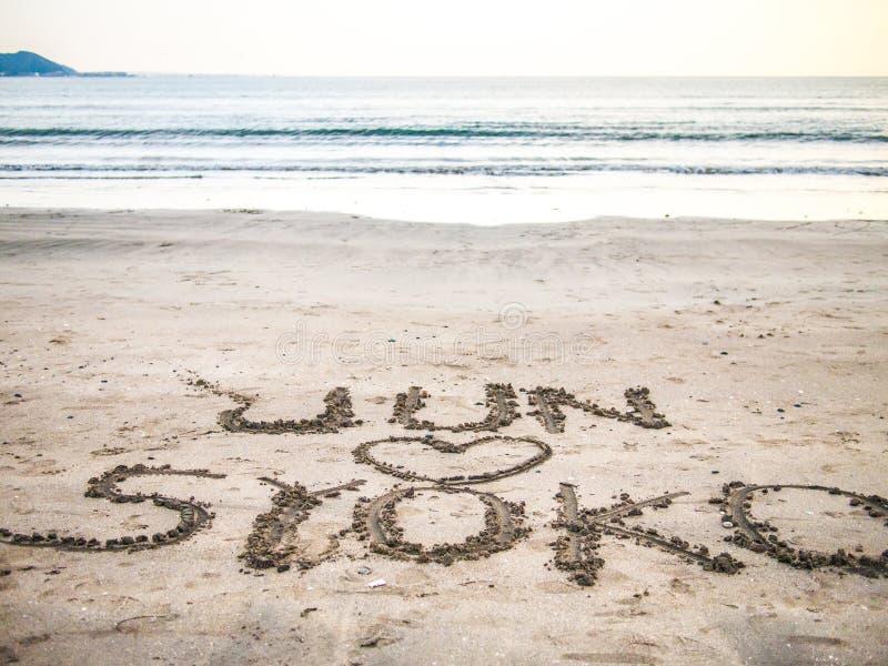 Love in Kamakura. Love message seen on the beach in Kamakura, Japan stock image