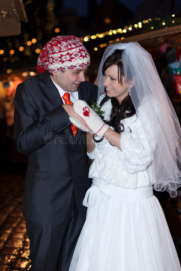 Love keeps warm. Newlyweds are trying to keep warm in cold weather stock image