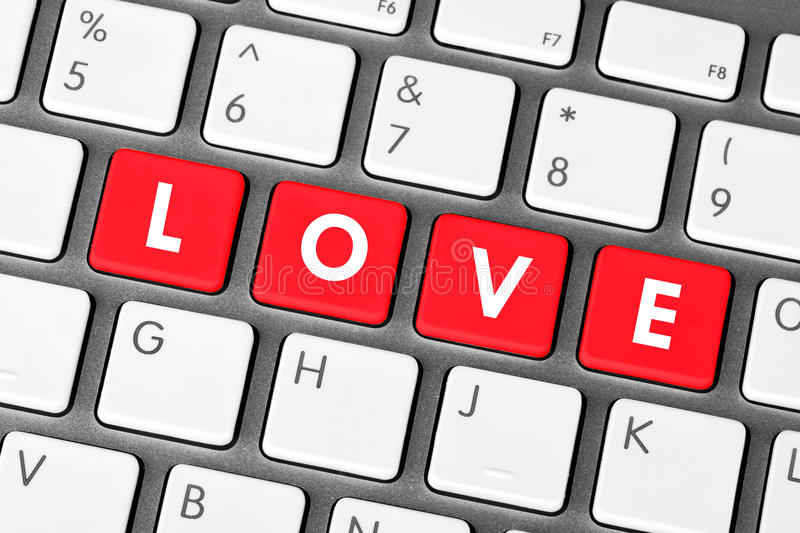 Love Keys. Closeup red love keyboard keys. Love concept stock photos
