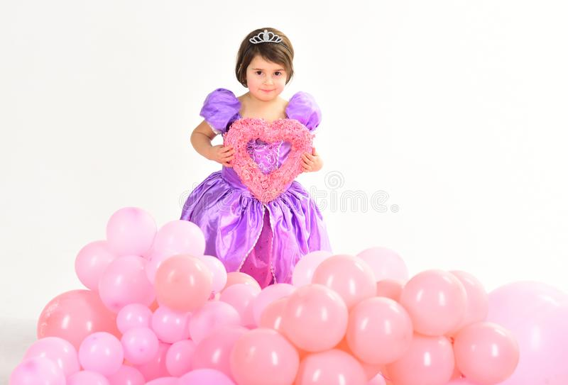 Love. Kid fashion. Little miss in dress. Little girl princess. Childhood happiness. Party balloons. Happy birthday. Childrens day. Small pretty child with stock images