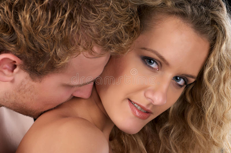 Love. He kiss her neck. stock images