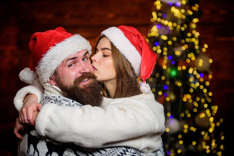Love kiss. merry christmas. love is in the air. family holiday weekend. lovers at decorated tree. winter season shopping royalty free stock images