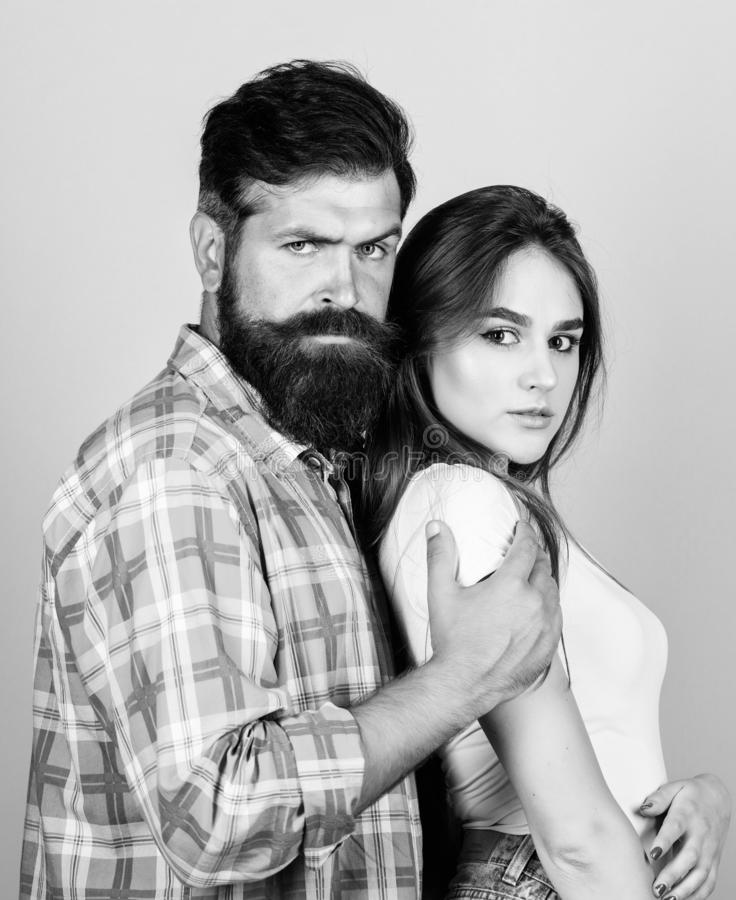 Love language. bearded man hipster with girl. hairdresser and barber concept. male and female fashion. valentines day stock image