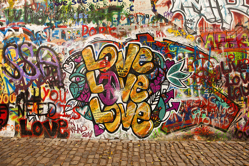 Love On The Lennon Wall. Prague, Czech Republic - October 7, 2010: A section of the Lennon Wall in the Little Town area of Prague near the Charles Bridge. This