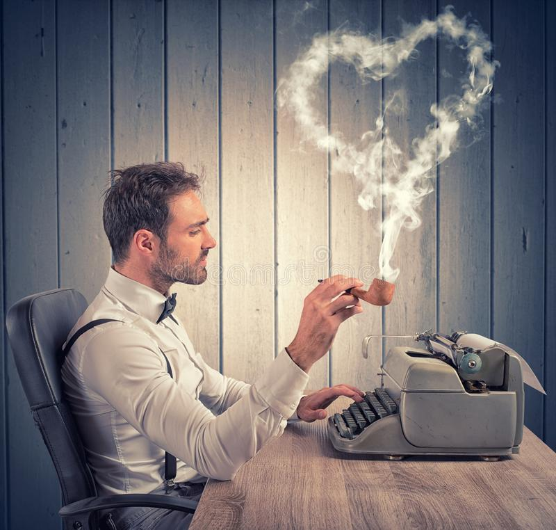 Love letter. A man writing a love letter for valentine day royalty free stock image