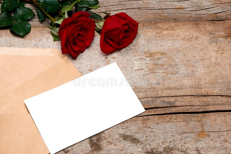 Love letter valentine rose and in envelope on wooden background royalty free stock photo