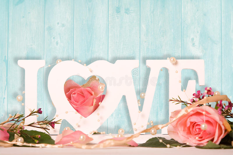Love. Letters decorated with roses royalty free stock images