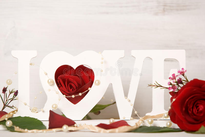 Love. Letters decorated with roses stock image