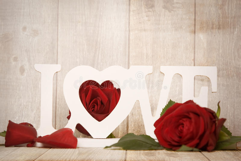 Love. Letters decorated with roses royalty free stock image