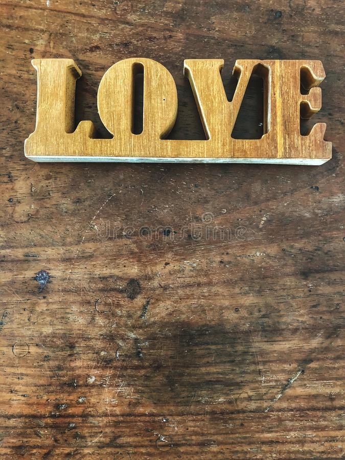 Love letters on the wooden table with natural sunlight, royalty free stock photo
