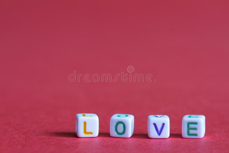 Love letters word on red background abstract valentines day concept. Closeup royalty free stock photography