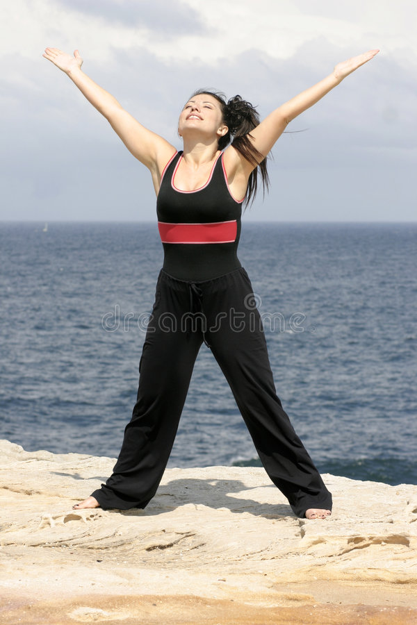 Love Life. Woman raises open arms in praise royalty free stock photo