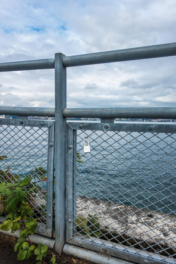 Love Lock On Fence. A love lock hangs from a fence at Alki Beach in West Seattle, Washington royalty free stock photos